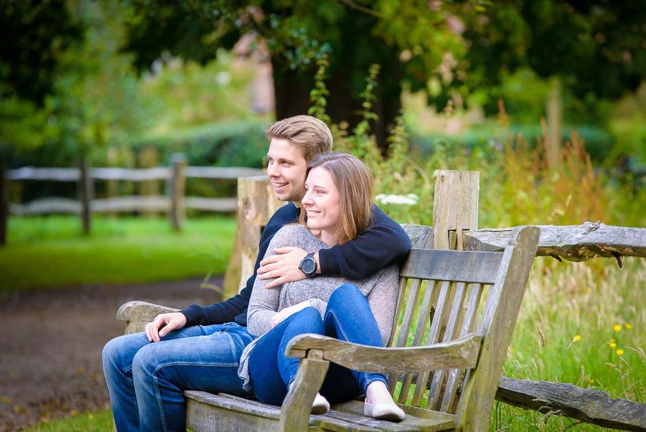 bride & groom sat on bench