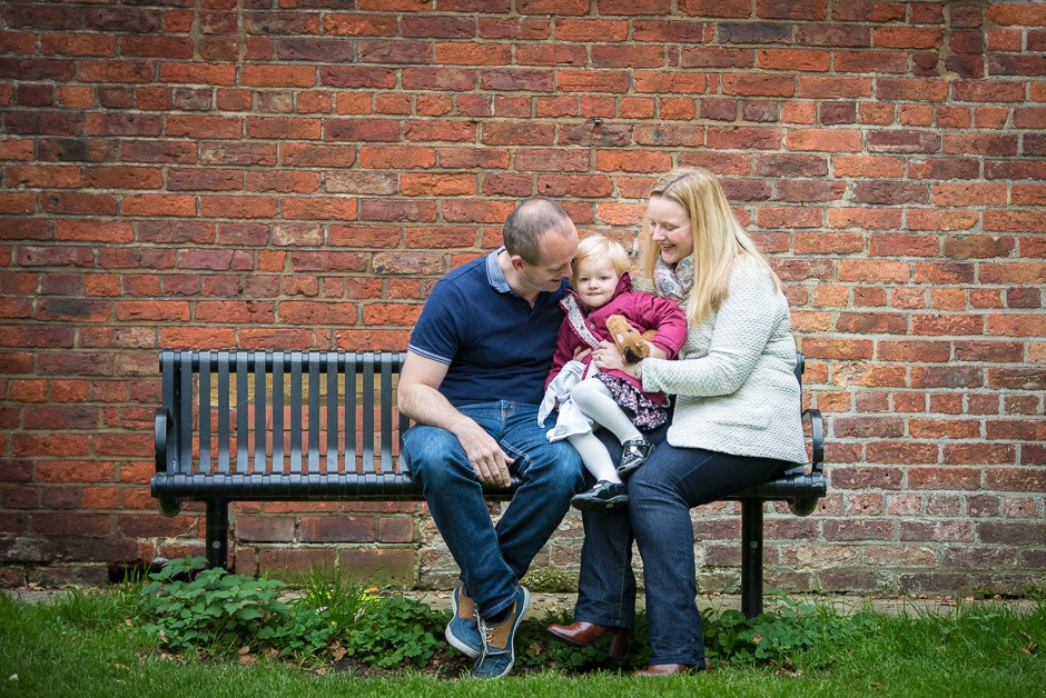 family sat on bench