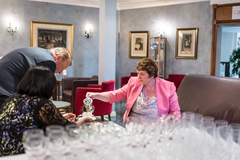 guest pouring tea