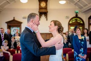 bride holds groom