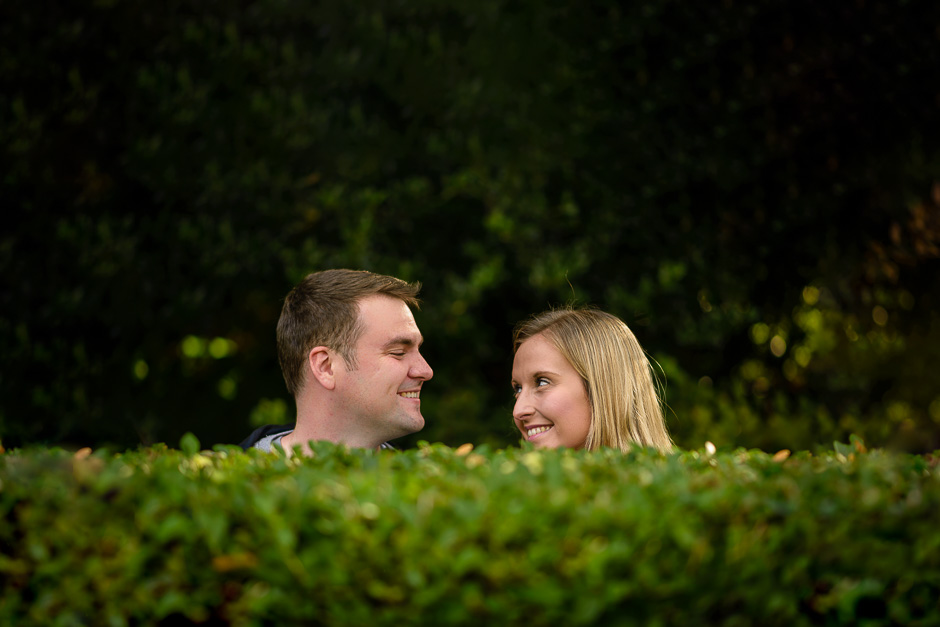 couple looking over hedge