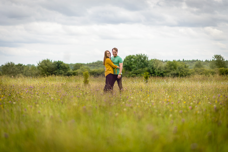 Couple hugging in field